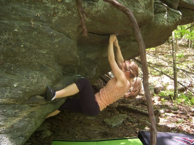 """Joanna Jennings working through the second move of """"Copperhead(V-3) on the contact boulder, the contact station, GHSP Virginia."""