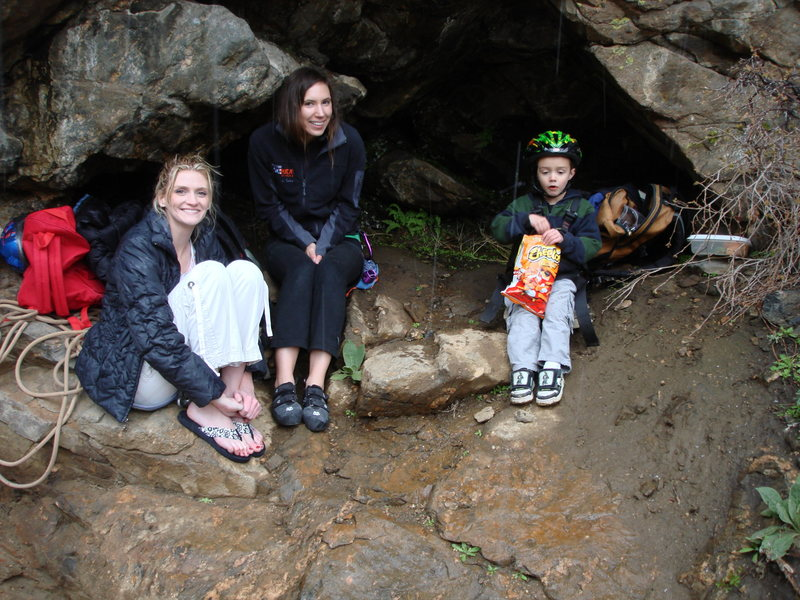 Mishel, Whitney & Noah taking shelter in shallow cave from the rain in Clear Creek. Picture taken by Mike Carrington.