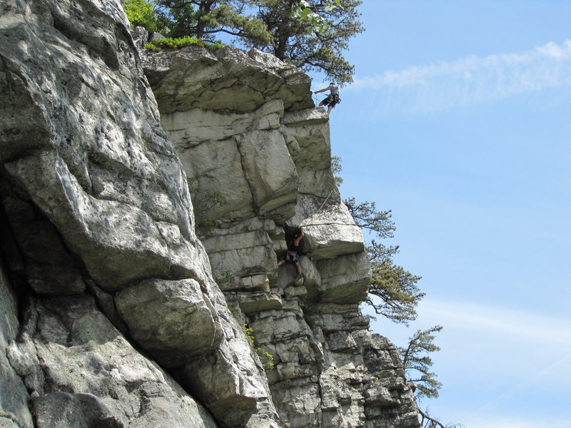 Unknown climber belaying his second, who is just about to enter the crux horizontal crack of P2 of Nurse's Aid. (Photo shot a little lower on rappel from the Limelight/Annie Oh! chains.  The Limelight traverse is visible in the foreground.)<br>