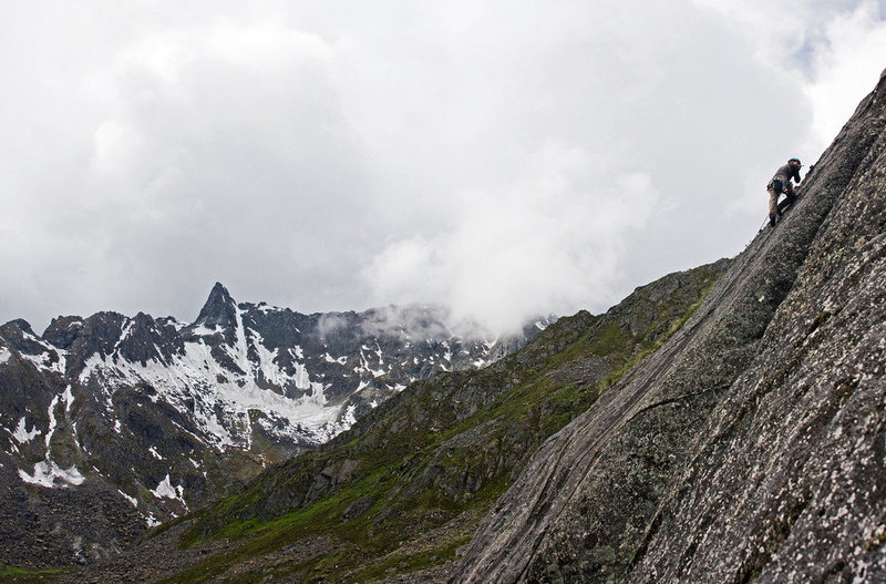 An unknown climber ascends Local Motion in Archangel Valley, Alaska. June 29, 2009.