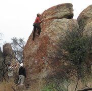 Rock Climbing Photo: The Extremist boulder.  The climber is topping out...