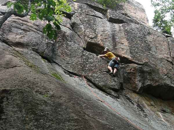 Adirondack Guidebook Author Jeremy Haas escapes the initial slab and begins the steep headwall portion of Recuperation Boulevard.