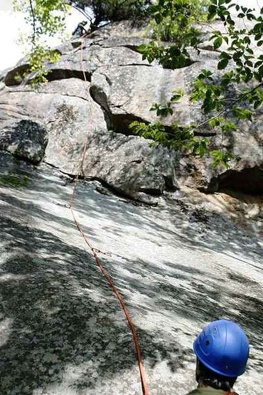 Alex reaches the belay anchor for Recuperation Boulevard. Note the 20' initial slab followed by 25' of steep, featured face.