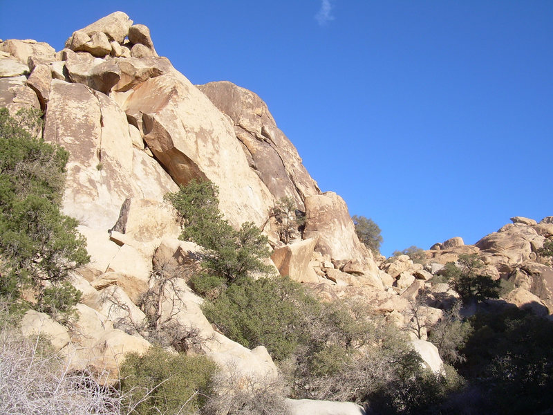 M.T. is located on the steep slab on the right side of this picture, below the chocolate colored rocks.
