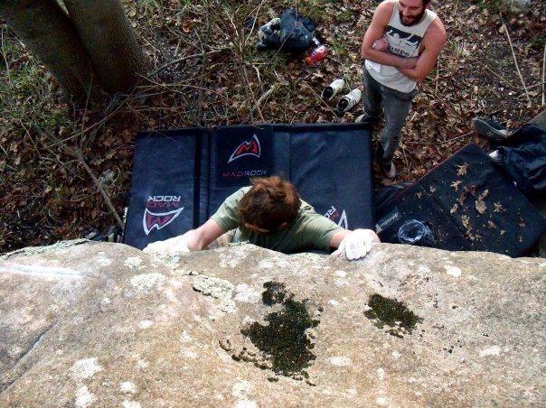"""Adam Walker on """"Out-House"""" (v-5+) at the roadside boulder, bluefield boulders."""