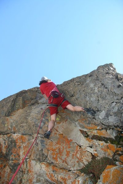 Climbing through the crux on the first ascent of Princess Vicious, 5.11b