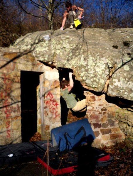 """Adam Walker on """"DoorWay"""" (V-4+) at the roadside boulder, bluefield boulders.<br>"""