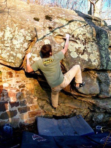 """Adam Walker on """"Out House"""" (V-5+) at the roadside boulder, bluefield boulders."""