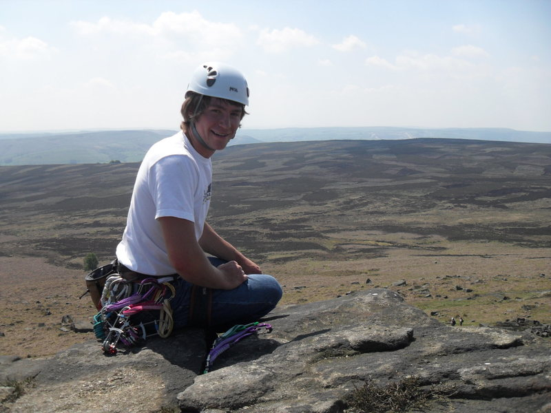 Belaying from the top of Exodus and the view over the Peak District.