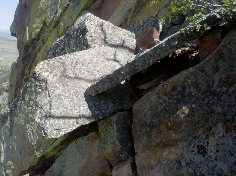 """The """"Death Blocks"""" at the Top of the P3 Belay.  They are easy to go around but rather precarious looking."""