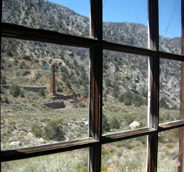 Room with a view! A view of the 65 foot tall smelting stack built in 1876 with the help of two rotten, crooked senators from Nevada. It was in operation for about a year at the cost of $210,000 of dirty, filthy money, and about a half million bricks. Oh well, at least we still get to enjoy the structure as a beautiful, historical site. It's so freaking cool! This pic was taken from the kitchen window of the &quot;Overflow Cabin&quot; we stayed at in Panamint City.<br> <br> <br> Taken 5/18/10