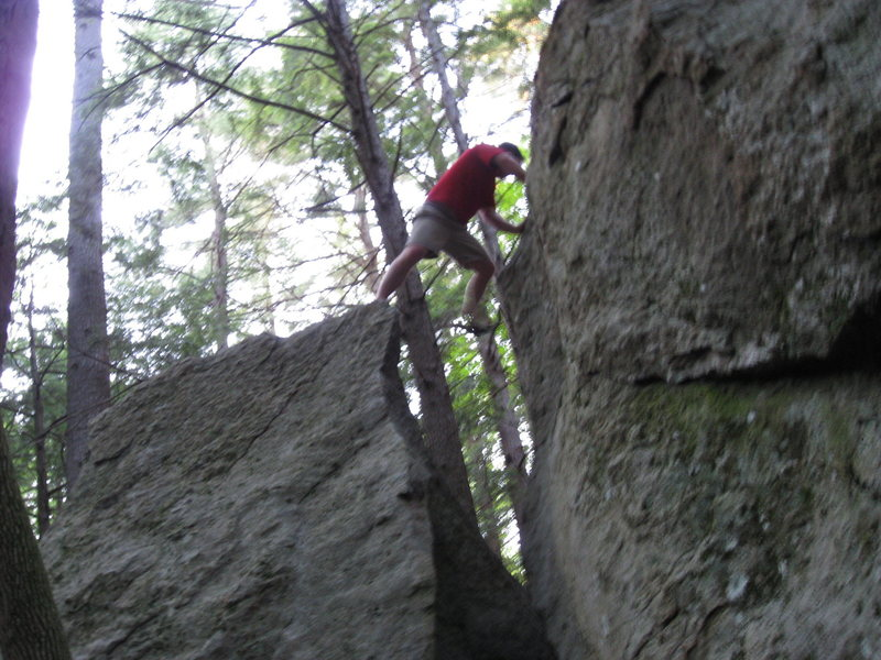 Out of the Pot and into the top out. You will want both feet on the boulder to the right before you top out.
