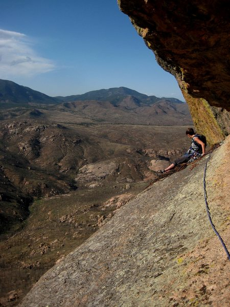 Angela soaking up the exposure and view from the P3 belay.