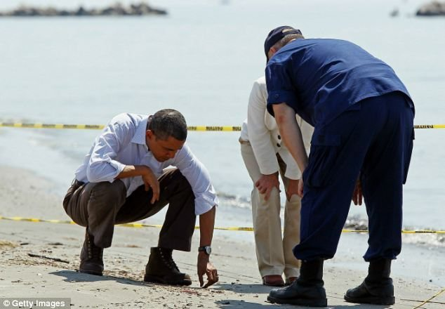 That's sand President Obama.  Not the same sand you hit your golf ball out of, this is con-tam-in-at-ed sand.  Silly litle boy, playing in the sand.
