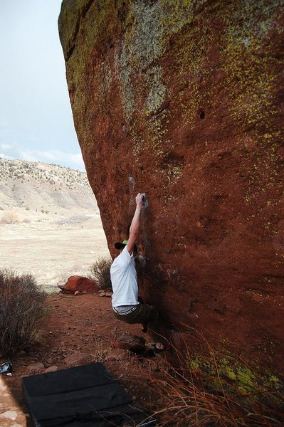 Jared LaVacque, enjoying a break between storms, on Ghost Dance V7,  Matthew Winters park, CO