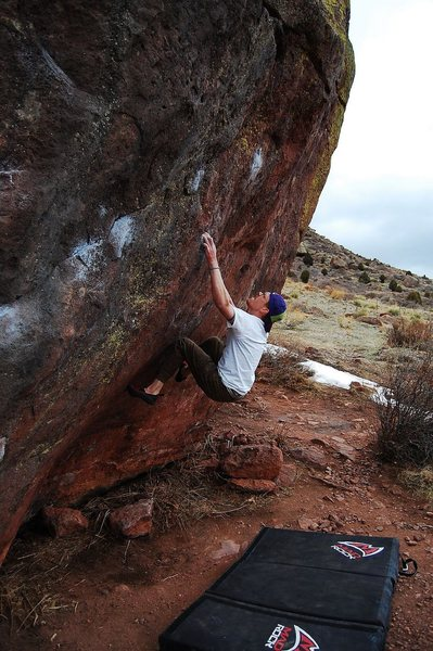 Jared LaVacque, setting up for the crux of Purity Control, V10, Matthew Winters Park, CO.