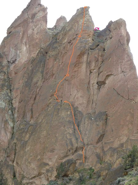 It's hard to get the exact line from this angle, particularly the anchor atop the 10a third pitch, but it's close.<br> The pink arrow gives a very approximate location for the descent rappel.