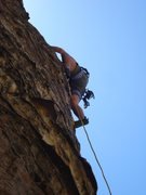 Climbing the first pitch of Prophesy Wall
