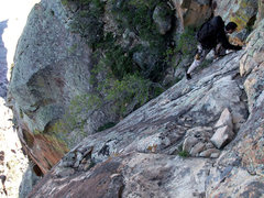 Rock Climbing Photo: the 5.4 step across move on the upper slabs
