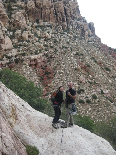 Our buddies Jason, and Anne displaying good team work when pulling ropes in Red Rock. <br> <br> It's not uncommon to need two people pulling ropes off of multi-pitches in Red Rock. Ropes could be stubborn SOBs on Red Rock's beautiful, featured rock.