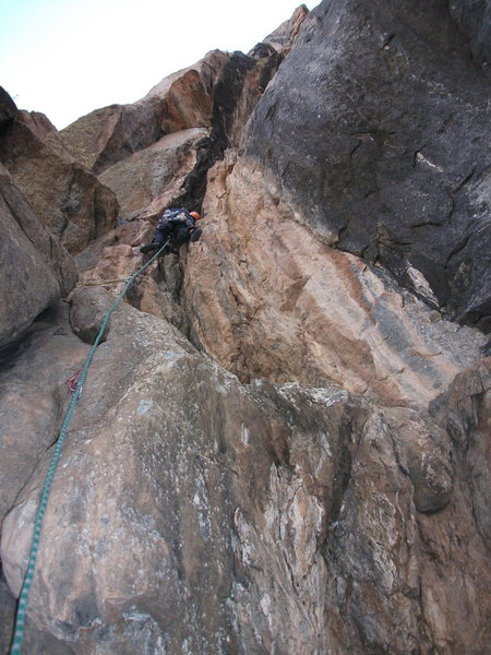 Getting started in the crux chimney.