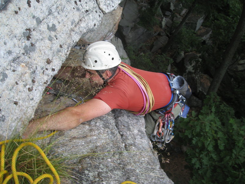 My partner squirming his way onto the second awkward shelf on the first pitch of Le Plie.
