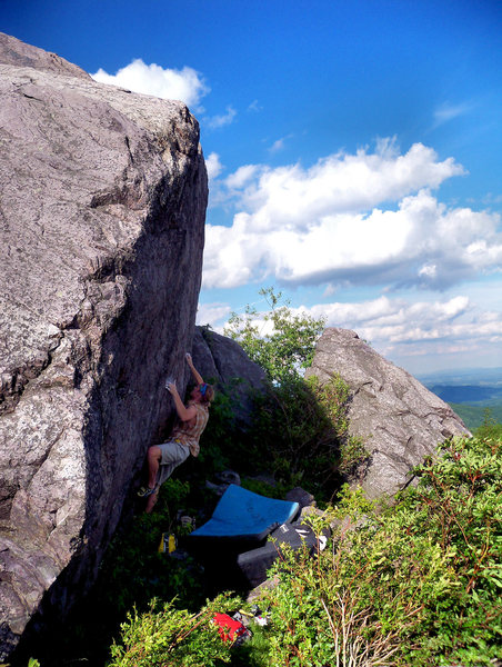 "Travis Melin climbing the ""Horizon Line"" (v6) in the Highlands Area, Grayson Highlands State Park, Virginia"