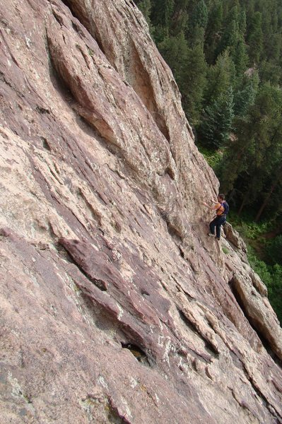 Van easing arond the corner to the base of a small dihedral on the begining of pitch 2.