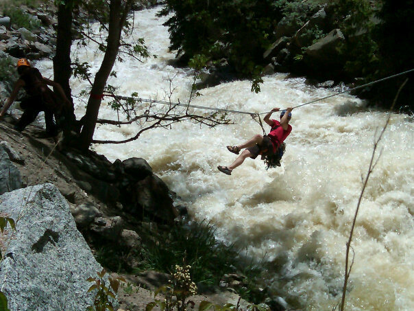 Cob rock tyrolean traverse, Boulder Creek was angry that day.