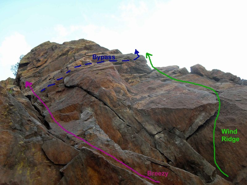 Starts of Breezy and Wind Ridge.<br> The purple line is the easy start to Breezy (5.5).  The harder (5.7) &quot;flake&quot; start to Wind Ridge is the green line, which I highly recommend.  Alternately, you can avoid the layback over the flake and do the easy Breezy start, then traverse right to join Wind Ridge (blue line) just above the flake.