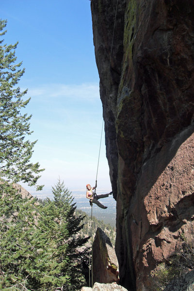 Brenda makes a long, beautiful rappel off the Matron in Sept 2009.