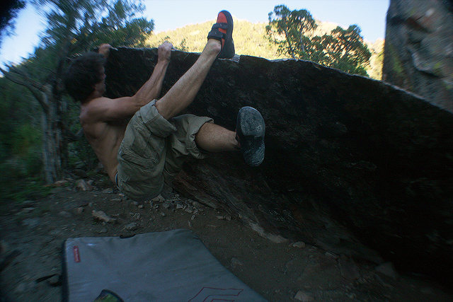 Traverse on the Lippy Boulder. Sit start on the far right without using the lip as either starting holds (to make it interesting).