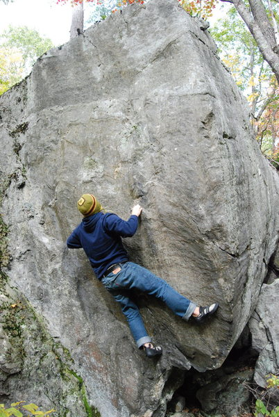 A tall unknown boulder problem.