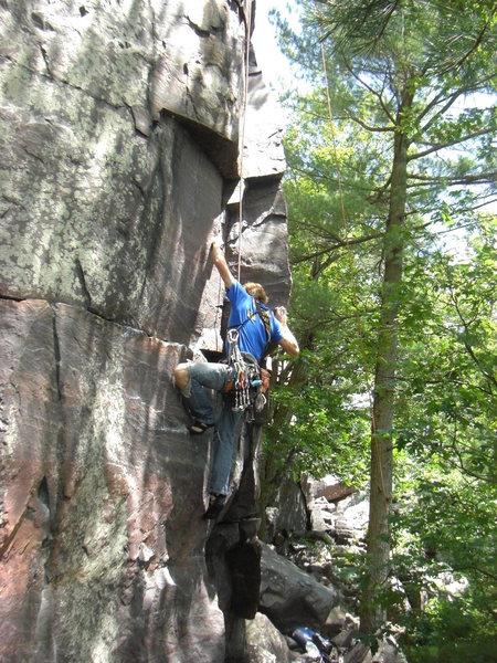 Rhoads pulling into the crux corner.<br> 6/16/10