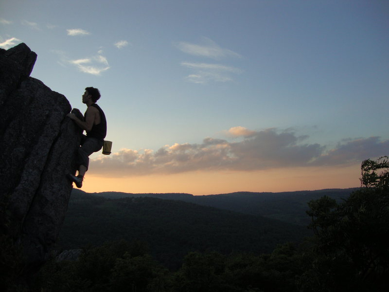 "Aaron James Parlier Topping out ""Sunset Arete"" at dusk."