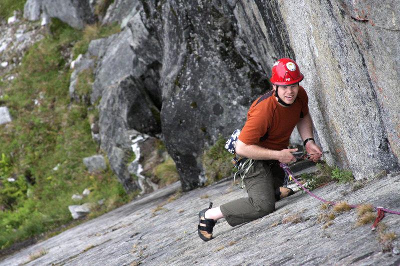 John Saari pauses to clean a nut, following up Aurora Slabialous in Archangel Valley, Alaska.