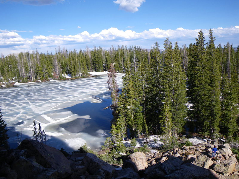 Peering down at a still frozen Cliff Lake from the base of Vulgaria... taken on June 19, 2010