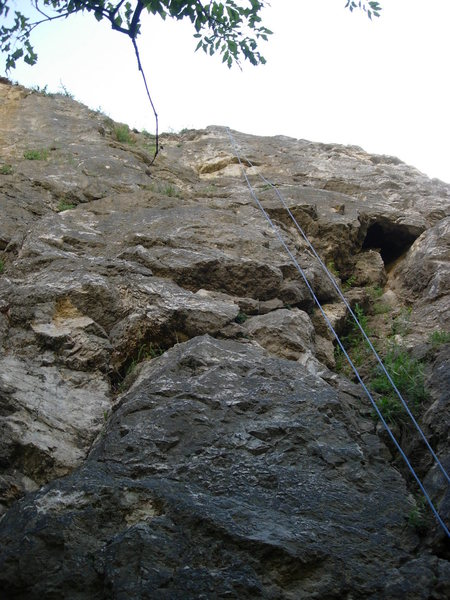 Városlakó at Róka Hegy.  The route follows the rope for the most part.  The beginning half is just to the left of the rope.  If you look closely, you can see the first two bolts.