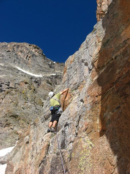 Andy Grauch starting up the first pitch of The Route That Kor Forgot on 6/20/10.  The far right side of the east face of Taylor Peak can be seen in the background. Photo by Chris Sheridan.