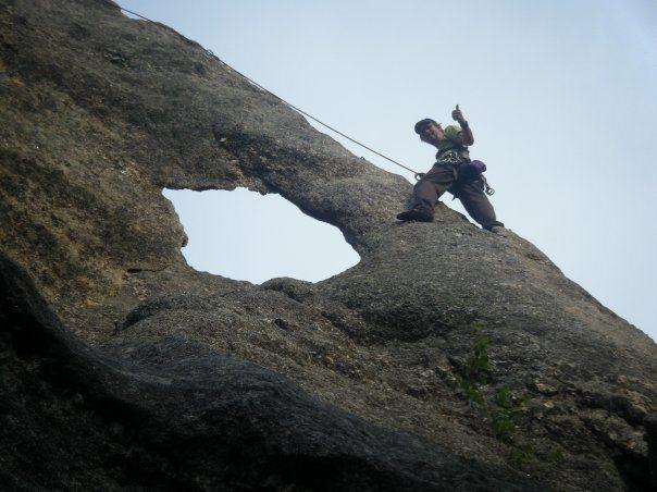 Gossamer, Rushmore Climbing Area. Cleaning the climb.