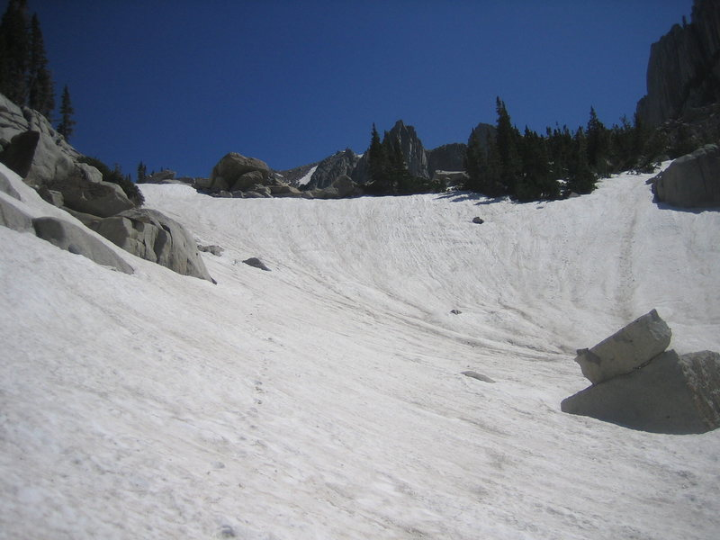 The short, steep section of snow, located just below the boulder field.