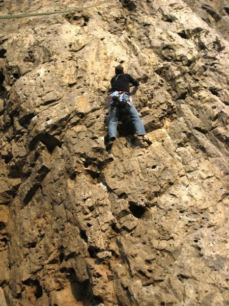 Nearing the top of the overhanging section on the first pitch of Le Cosmos