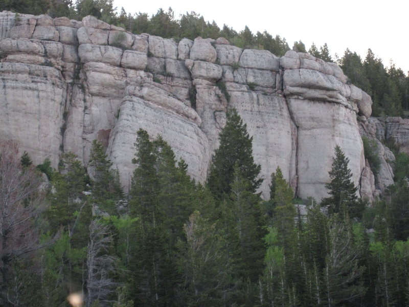 The Cowboy King Wall consists of the two sections of rock on the right side of the photo (to the right of the leaning block/wall). The two sections of the wall are separated by a doglegged break in the cliff.