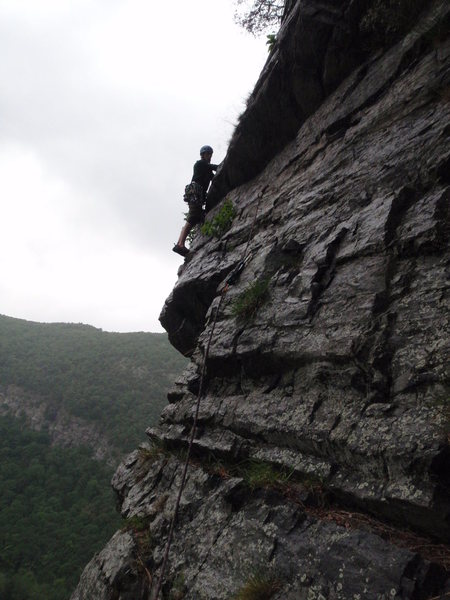 Rock Climbing Photo: Ryan leading the top of Triumvirate in the rain.  ...