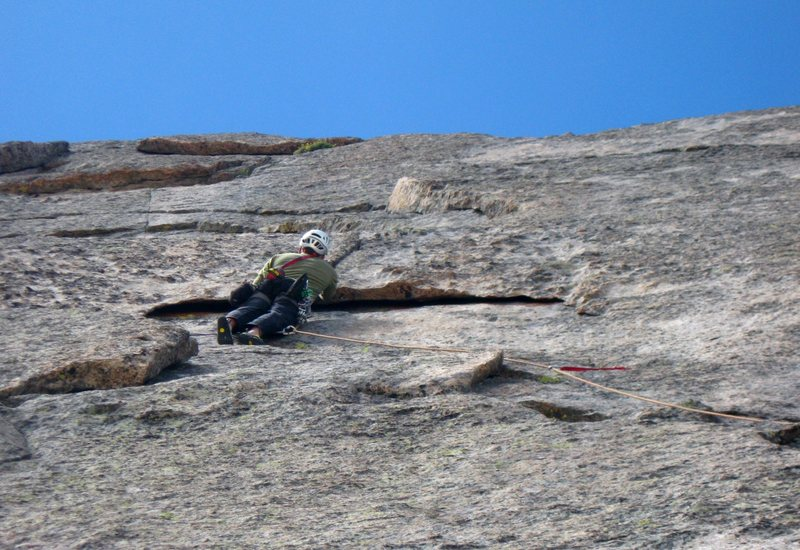 "Looking up at the ""half circle"".  Great 5.10 finger locks to pull over the roof."