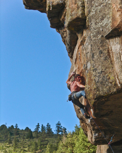 Darren finishing the crux.<br> <br> Photo by Angela Dembik.