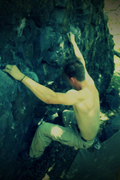 Mike DeWitt working his feet from final crimpers before the slopers on Heavy Metal Traverse