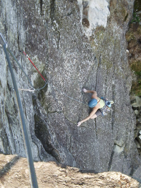 Mary starting the final overhanging section on Star Trekkin', P2 or P3 depending.