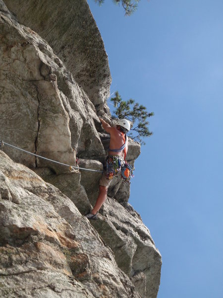 Dustin pulling up the 5.7 exit.  Heads up to the small pine, then traverses right into the notch.