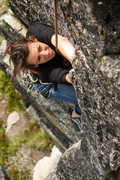 Rock Climbing Photo: Rachel eyes the holds ahead during a sunny day in ...